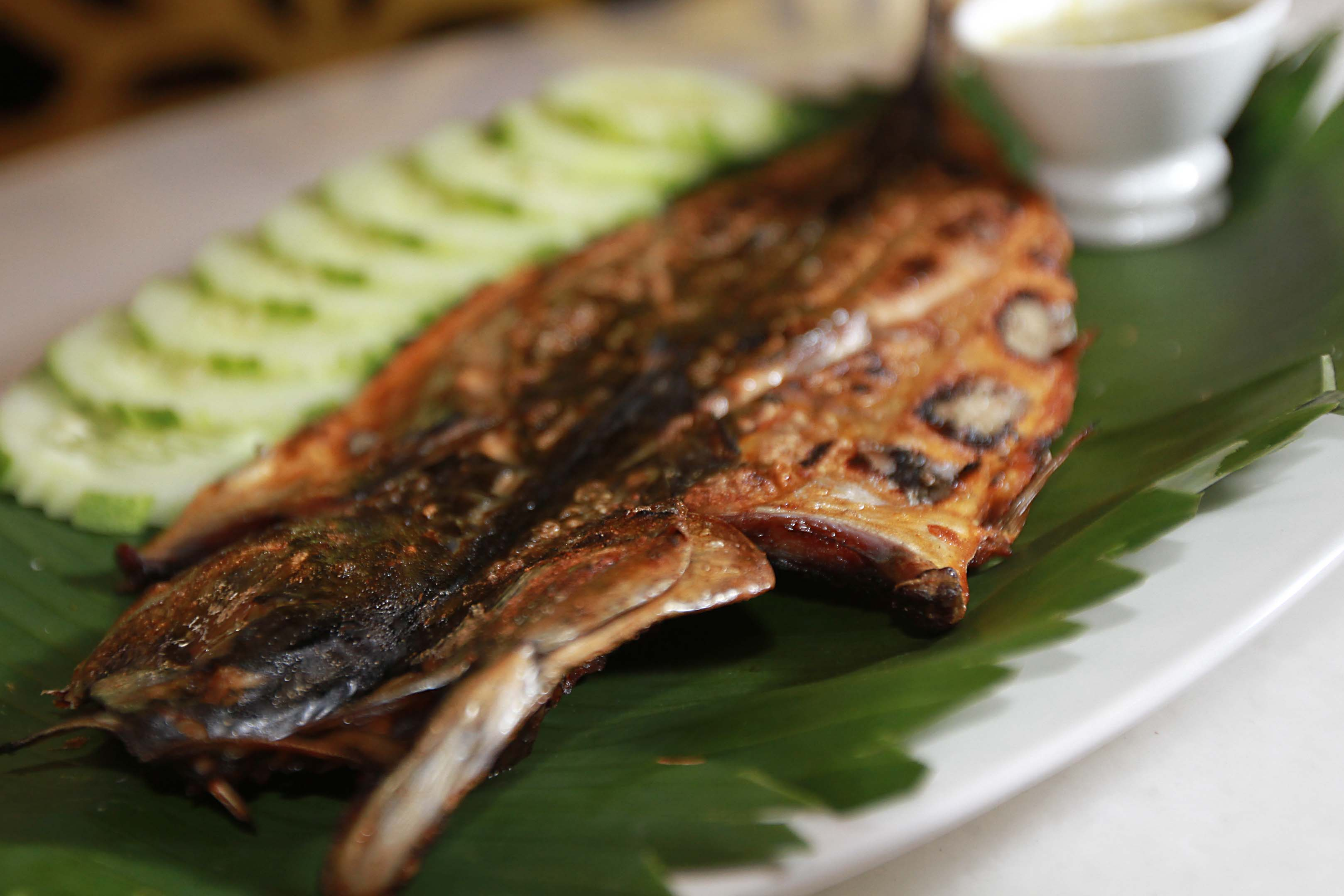 Grilled to perfection: Barbecued saba fish goes well with sambal dip.
