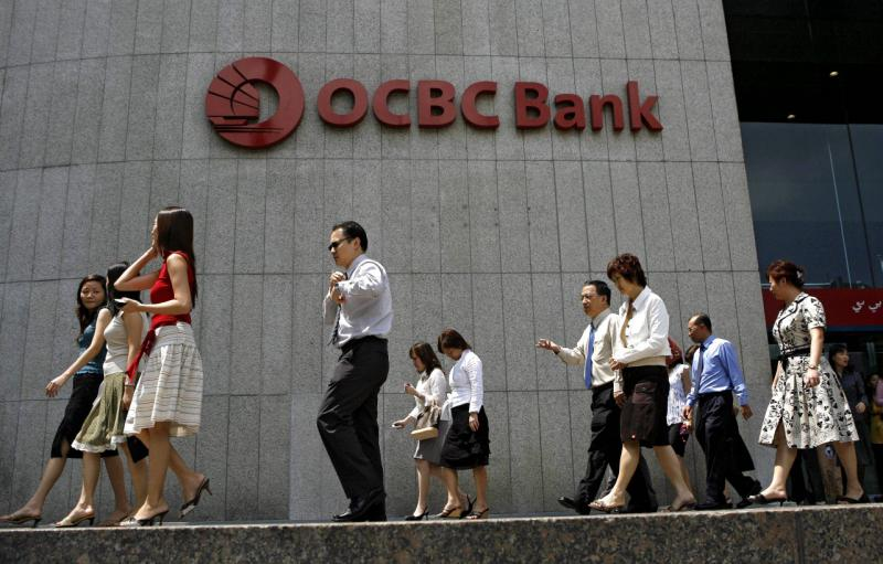 OCBC earned S$921mil (US$739mil) in the three months ending in June, compared with S$597mil a year earlier - AFP Photo.