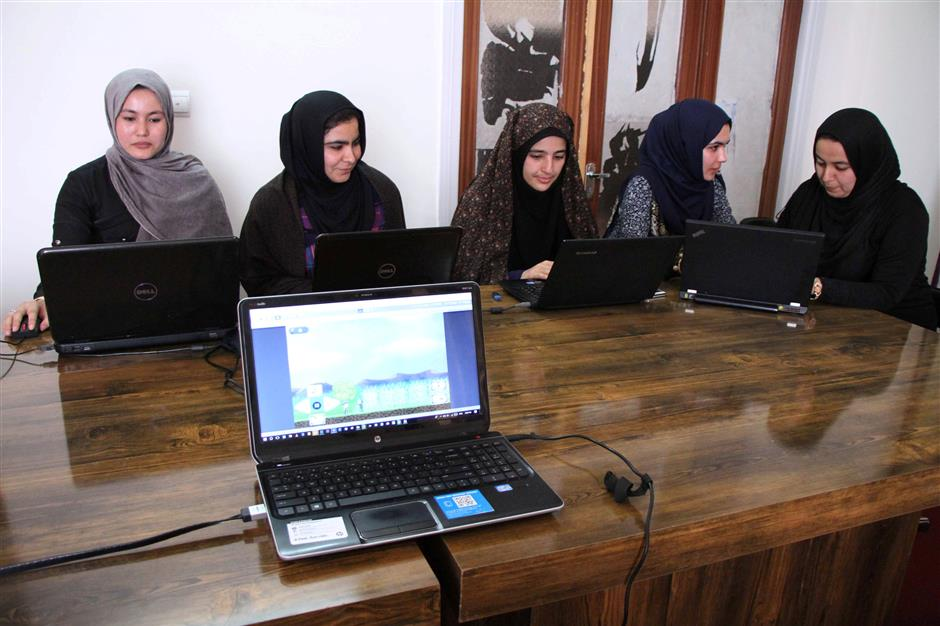 Afghan coders practice at the Code to Inspire computer training center in Herat, Afghanistan April 24, 2018. Picture taken April 24, 2018. REUTERS/Mohammad Shoib
