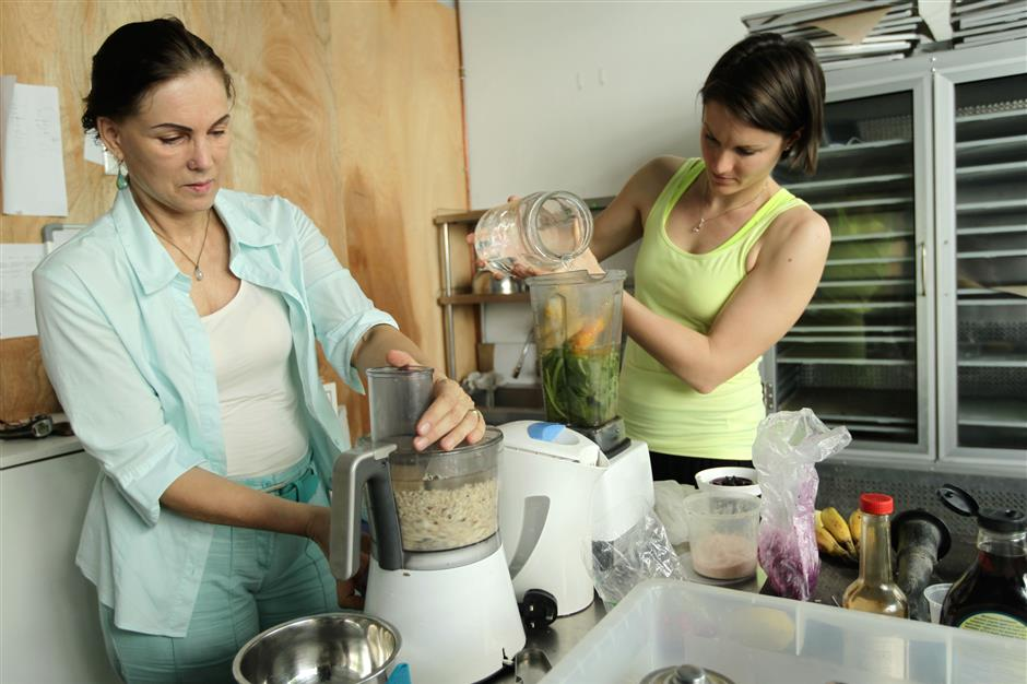 Elke Wollschon (left) and Carina Lipold of Delicious Detox Delivery believe that eating raw is the way to go.