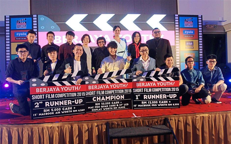 1 The Top 10 finalists with the judges at the awards presentation ceremony of Berjaya Youth Short Film Competition 2015 at Berjaya Times Square Hotel Kuala Lumpur. 2 Afdlin was among the returning judges for the short film competition. 3 Gayatri found the short films to be entertaining and an overall improvement compared to previous years.