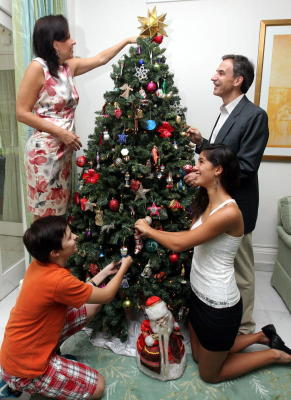 Keeping tradition alive: Decorating the Christmas tree together is a yearly ritual in the home of US Ambassador to Malaysia, Datuk Paul W. Jones.
