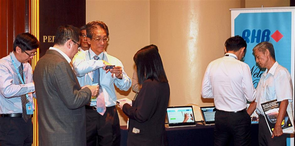 RHB Bank personnel offering information on the bank's products and services on the sidelines of the SOBA Lab workshop.