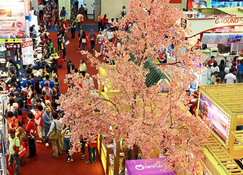 Pretty sight: The Japan Pavilion attracting the crowd with its decor, which includes a Sakura tree.
