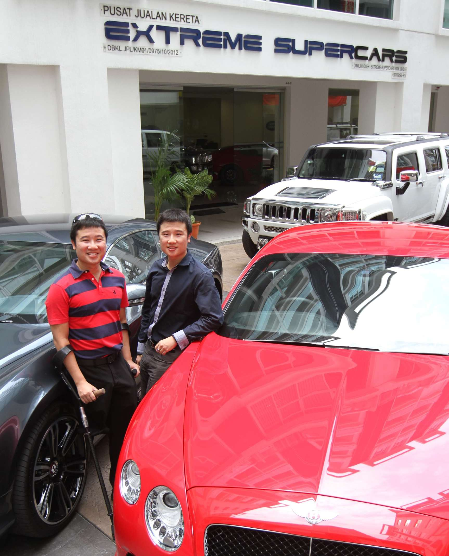 Young and enterprising: Melvin (left) and Kelvin Tong, founders of luxury car dealership, Extreme Supercars.