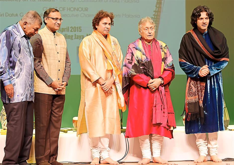 Guests and performers: (From left) Gnanalingam, Tirumurti, tabla extraordinaire Satyajit Talwalkar, Ustad Amjad and his son, Ayaan at the Soorya India Festival.