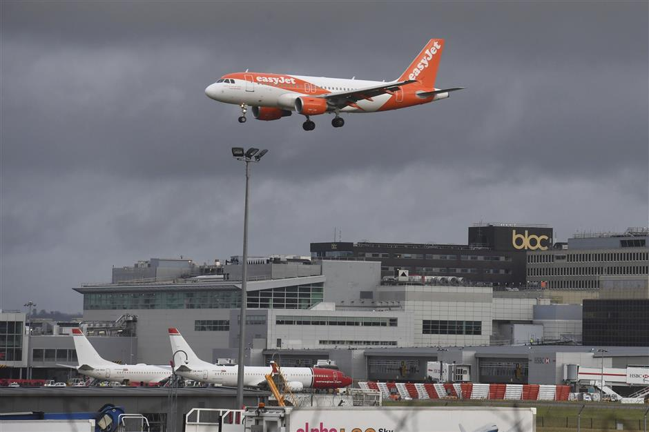 An EasyJet plane on its final approach before landing at Gatwick airport near London, Friday Dec. 21, 2018. Flights resumed at London\'s Gatwick Airport on Friday morning after drones sparked the shutdown of the airfield for more than 24 hours, leaving tens of thousands of passengers stranded or delayed during the busy holiday season. (John Stillwell/PA via AP)