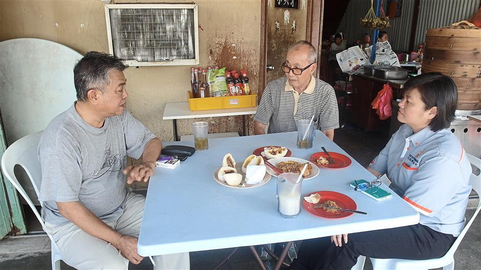 (From left) Tan Chee Kiat, Kiew Wun Fui and Tan Sin Dee outside Kiews coffee shop in Dengkil New Village.