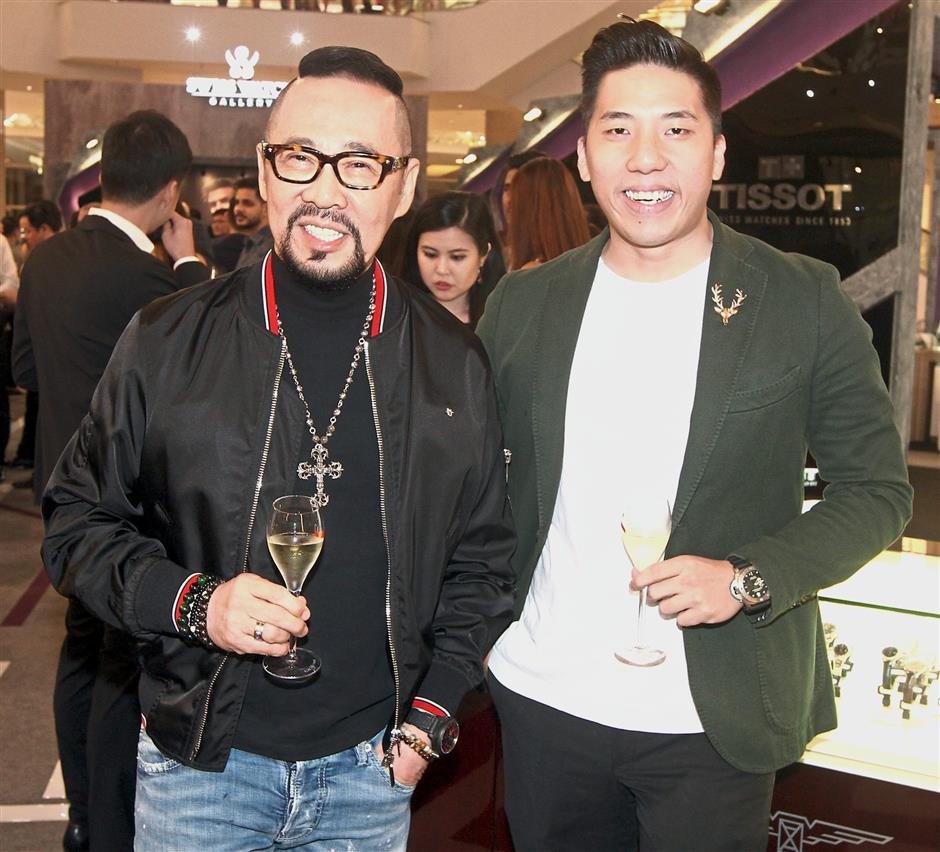 Datuk Kelvin Tan (left) and Billy Ooi were among the guests at the watch showcase.