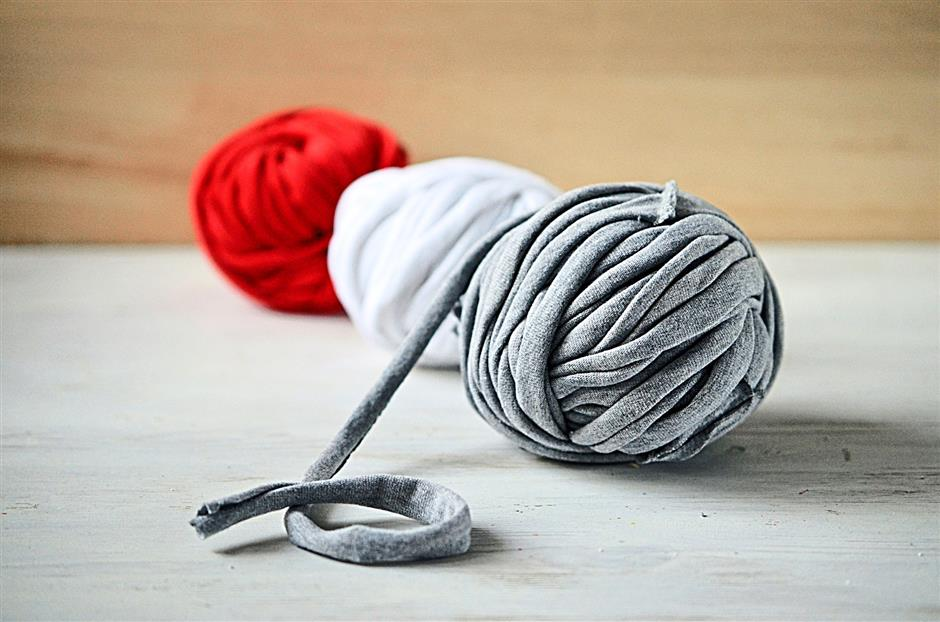 Whip old T-shirts into balls of yarn.