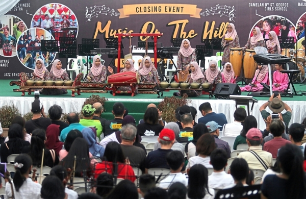 Visitors enjoying   the Gamelan       performance by  students from St Georgeu2019s Girls School during the Music on the Hill      u2013 East Meets West musical show on Penang Hill. u2014Photos: ZHAFARAN NASIB/The Star