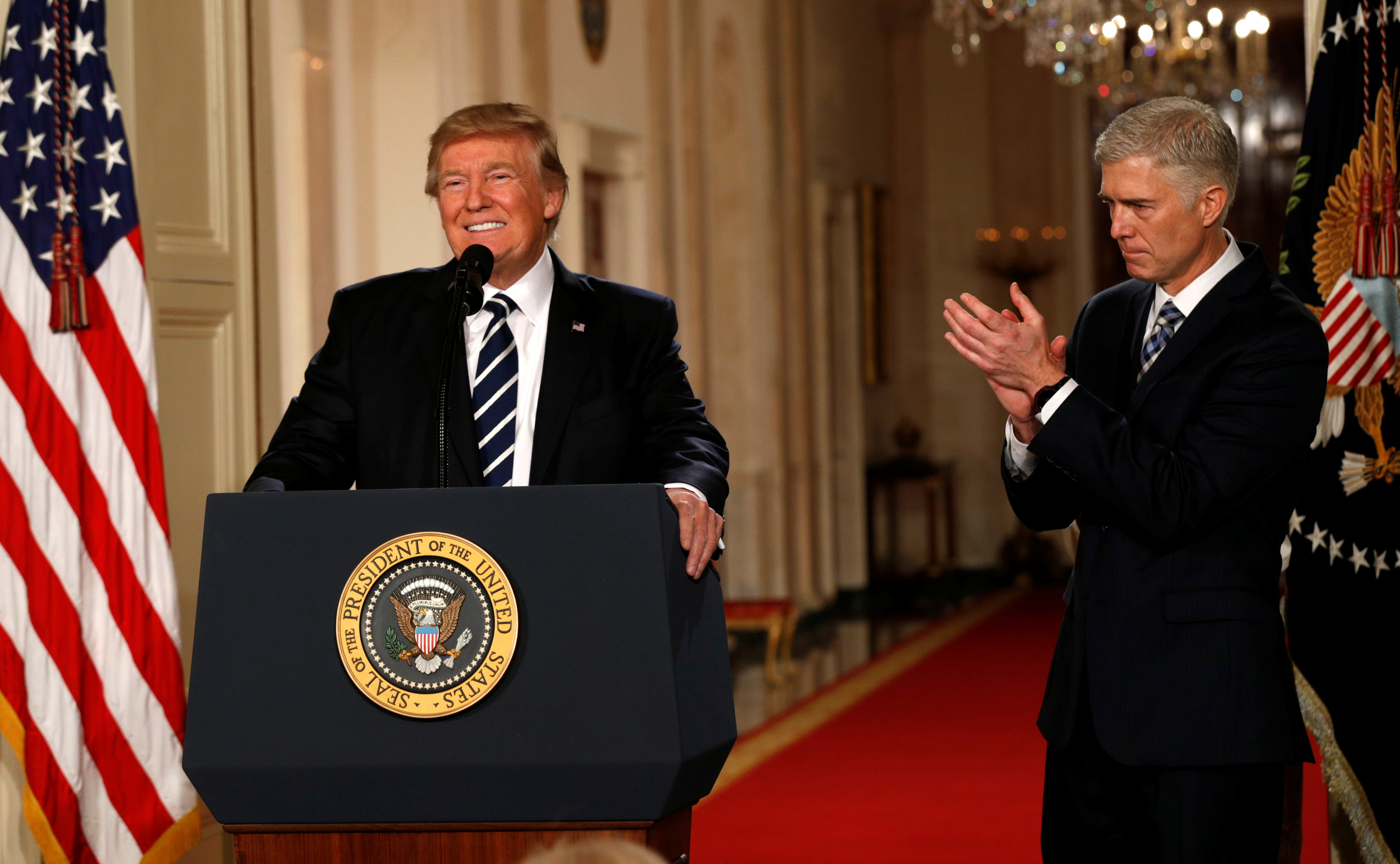 FILE PHOTO: U.S. President Donald Trump announces his nomination of Neil Gorsuch to be an associate justice of the U.S. Supreme Court as Gorsuch (R) applauds at the White House in Washington, U.S., January 31, 2017. REUTERS/Kevin Lamarque/File Photo