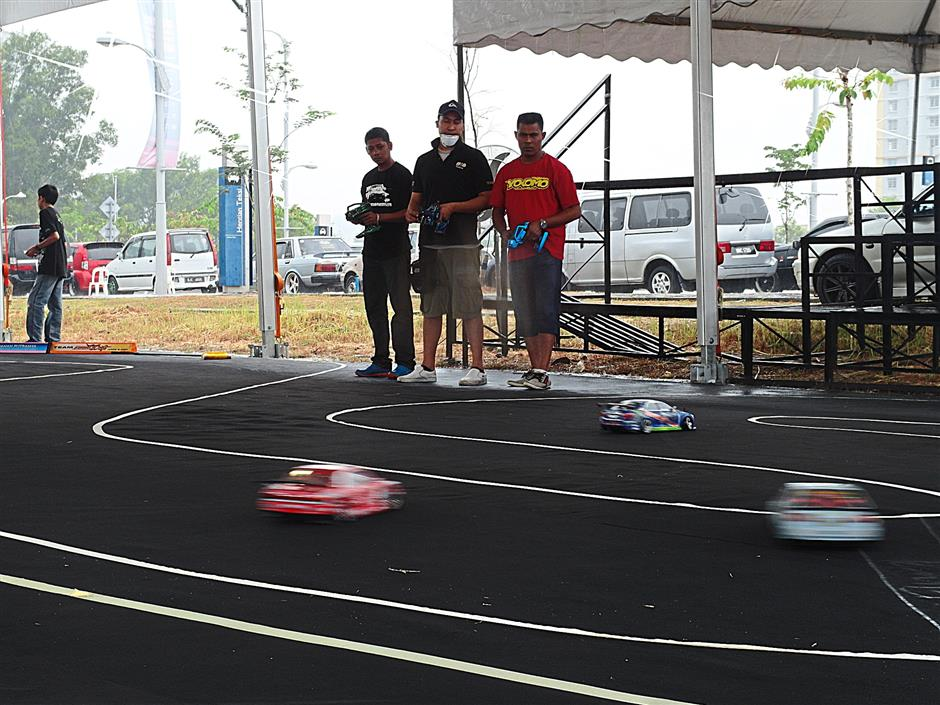 RC cars competing in the drifting category at the Putrajaya RC Event 2014.