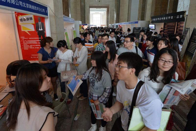 Chinese jobseekers attend a jobs fair in Beijing in this file photo. China\'s economy added 10.82 million new jobs in the first nine months of 2014, and the jobs are expected to total 13 million for the whole year - AFP Photo.