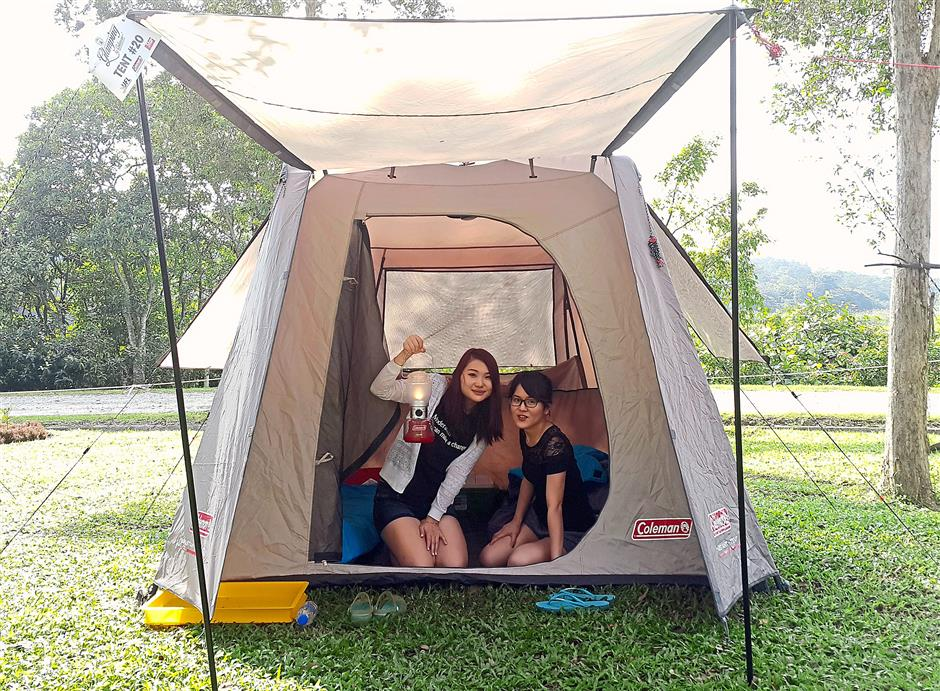 Home sweet home: Participants Kelly Tey (left) and Yip Yoke Teng in their tent which was equipped with two air mattresses and a portable light and fan.