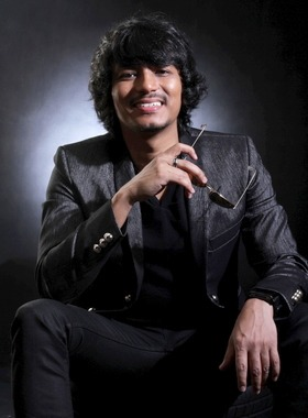 Behind the shades: Pop singer Faizal Tahir wants to take a more serious career direction and he is pumped up to get the job done. u2013 RAYMOND OOI / The Star