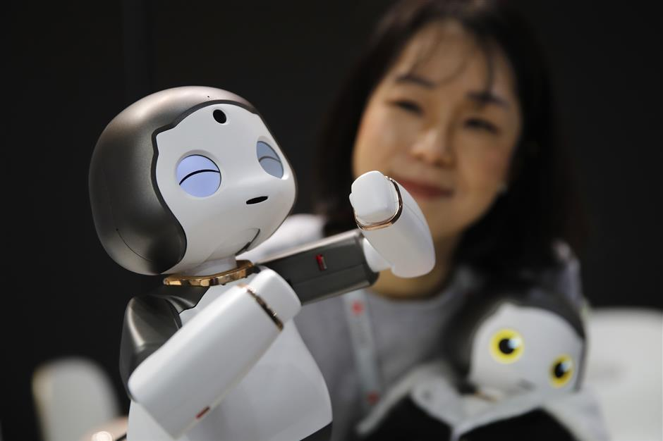 A LIKU baby humanoid robot is demonstrated on the Torooc Inc. stand on the opening day of the MWC Barcelona in Barcelona, Spain, on Monday, Feb. 25, 2019. At the wireless industryu2019s biggest conference, over 100,000 people are set to see the latest innovations in smartphones, artificial intelligence devices and autonomous drones exhibited by more than 2,400 companies. Photographer: Stefan Wermuth/Bloomberg