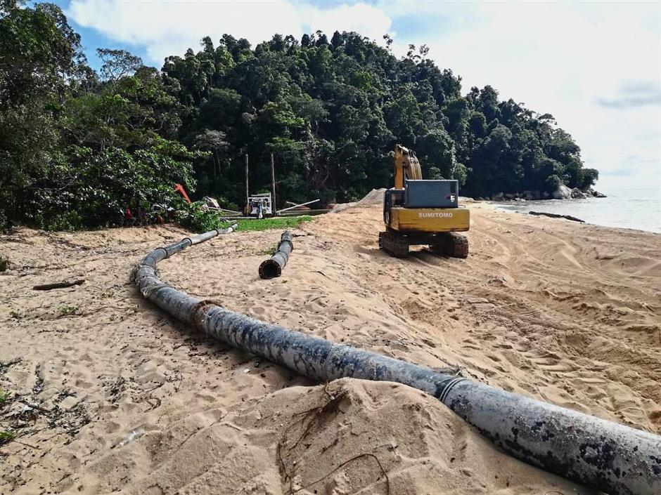 An excavator and pipe located near the ?estuary?.