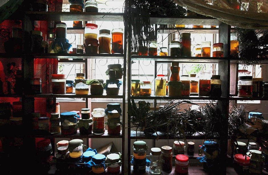 Black magic horror: As shown in the movie 'Dukun', jars filled with oily substances, some containing strands of hair, were found in Mona's house.