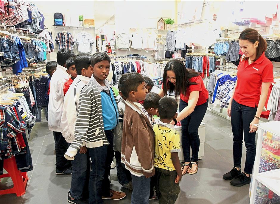 Eleven children from Rumah SVP received clothes courtesy of Poney at Sunway Pyramid.