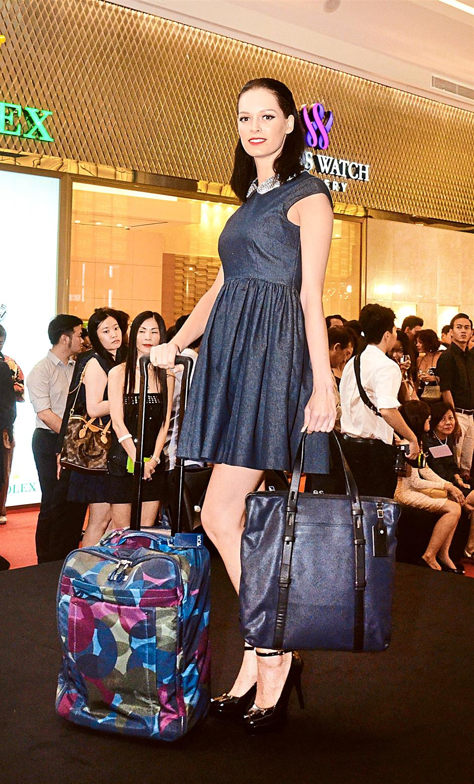 Models showing off stylish travel gear from American travel and lifestyle brand Tumi.
