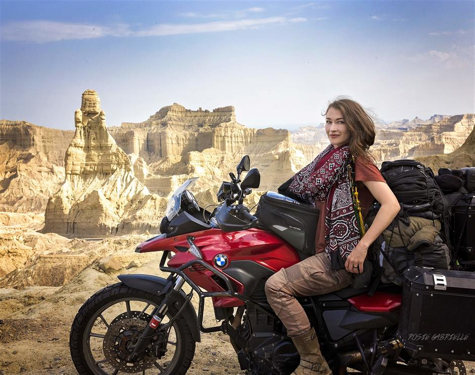 """CORRECTION - This handout picture taken on March 18, 2019, and released by Canadian tourist Rosie Gabrielle shows Gabrielle posing on her motorbike during a trip in the southwestern Balochistan province in Pakistan. - They are young, Western, and full of praise for Pakistan: Travel influencers have discovered the land of the pure but critics warn their rose-tinted filters are selling an inaccurate picture of the conservative, militancy-scarred country. (Photo by HANDOUT / Rosie Gabrielle / AFP) / TO GO WITH: Pakistan-travel-socialmedia-influencers-security, FEATURE by Joris Fioriti -----EDITORS NOTE --- RESTRICTED TO EDITORIAL USE - MANDATORY CREDIT 'AFP PHOTO / Rosie Gabrielle ' - NO MARKETING - NO ADVERTISING CAMPAIGNS - DISTRIBUTED AS A SERVICE TO CLIENTS - NO ARCHIVES / """"The erroneous mention[s] appearing in the metadata of this photo by HANDOUT has been modified in AFP systems in the following manner: [ADDS HANDOUT RESTRICTIONS]. Please immediately remove the erroneous mention[s] from all your online services and delete it (them) from your servers. If you have been authorized by AFP to distribute it (them) to third parties, please ensure that the same actions are carried out by them. Failure to promptly comply with these instructions will entail liability on your part for any continued or post notification usage. Therefore we thank you very much for all your attention and prompt action. We are sorry for the inconvenience this notification may cause and remain at your disposal for any further information you may require."""""""