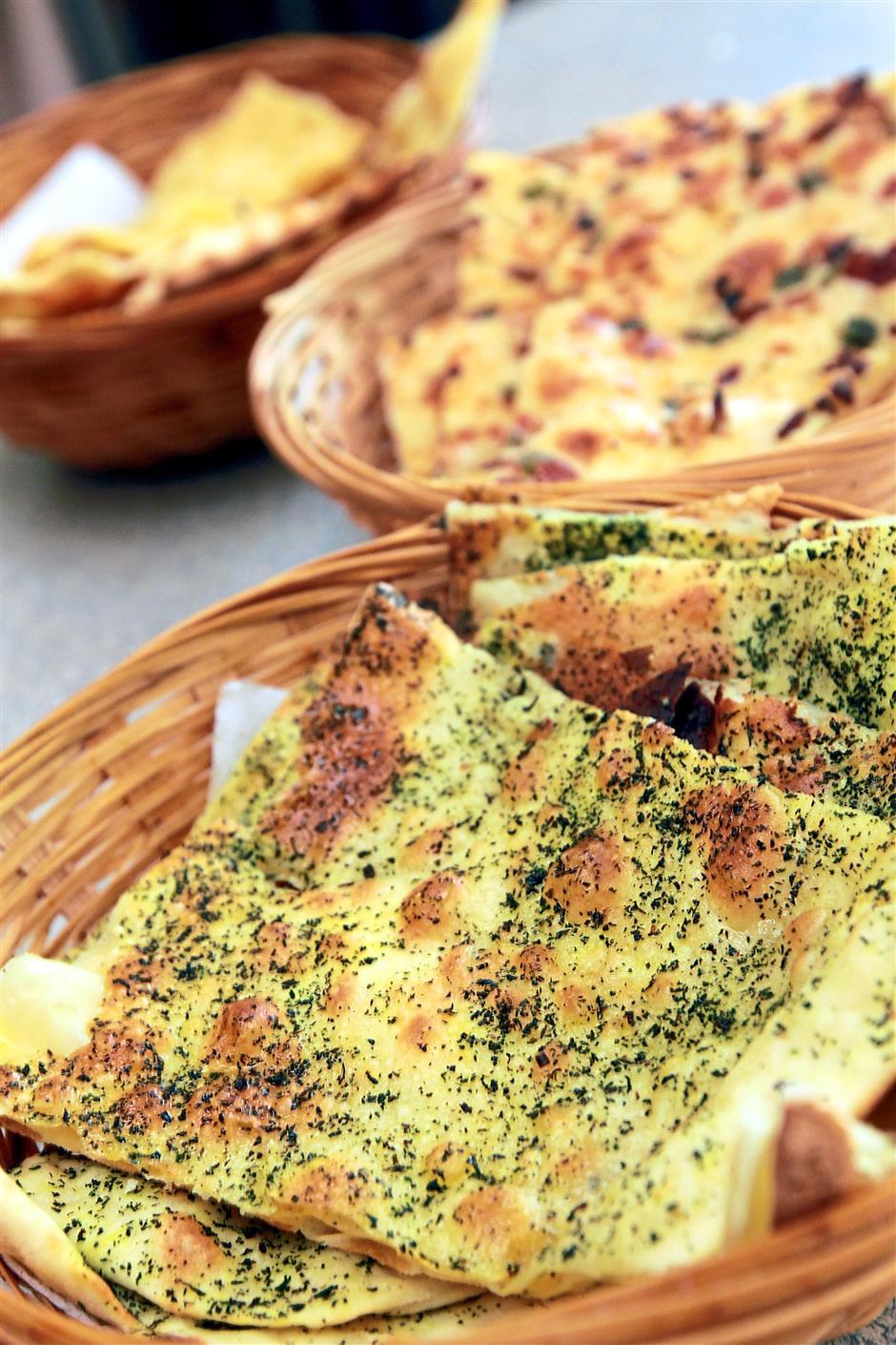 Different breads: (from top) Garlic naan, Kashmiri naan and Pudina Prata.