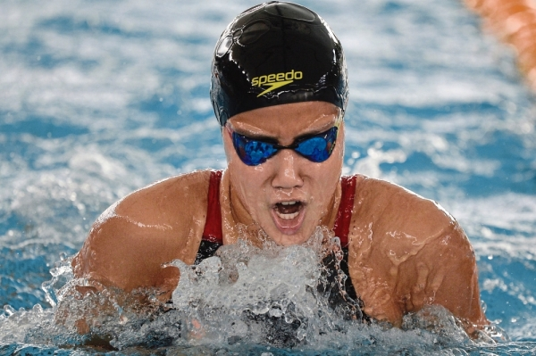 Another victory: Johor's Alicia Li Ann Soosai splashing her way to the 50m women's breaststroke gold medal in the Malaysian Open yesterday. — Bernama