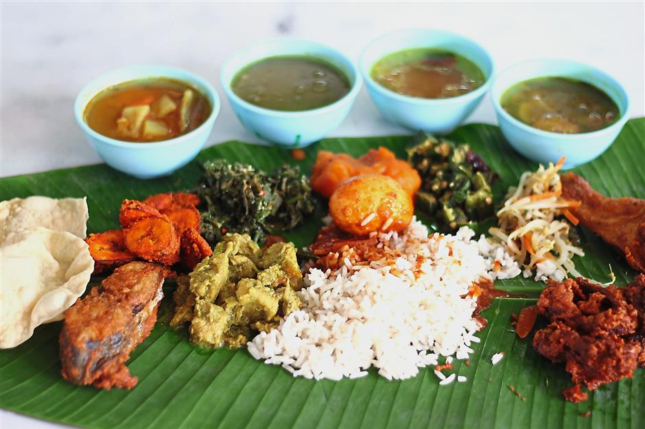 Banana leaf rice - 10 Must Try Rice Dishes in Malaysia | Ummi Goes Where?