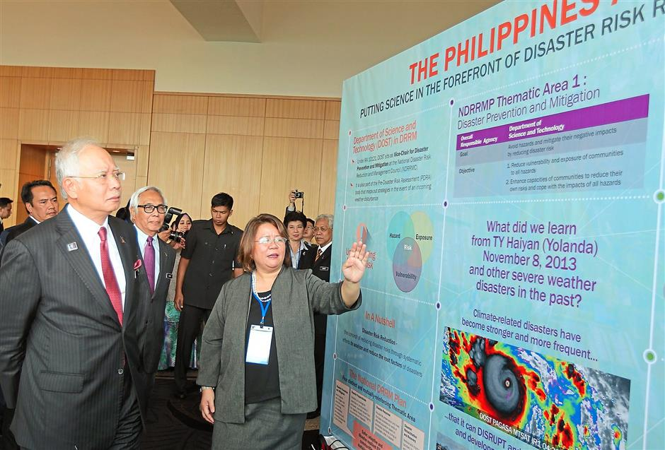 Rapt attention: Najib listening to Philippine Department of Science and Technology Undersecretary Rowena Christina L. Guevara at the Apec meeting in Kuala Lumpur.