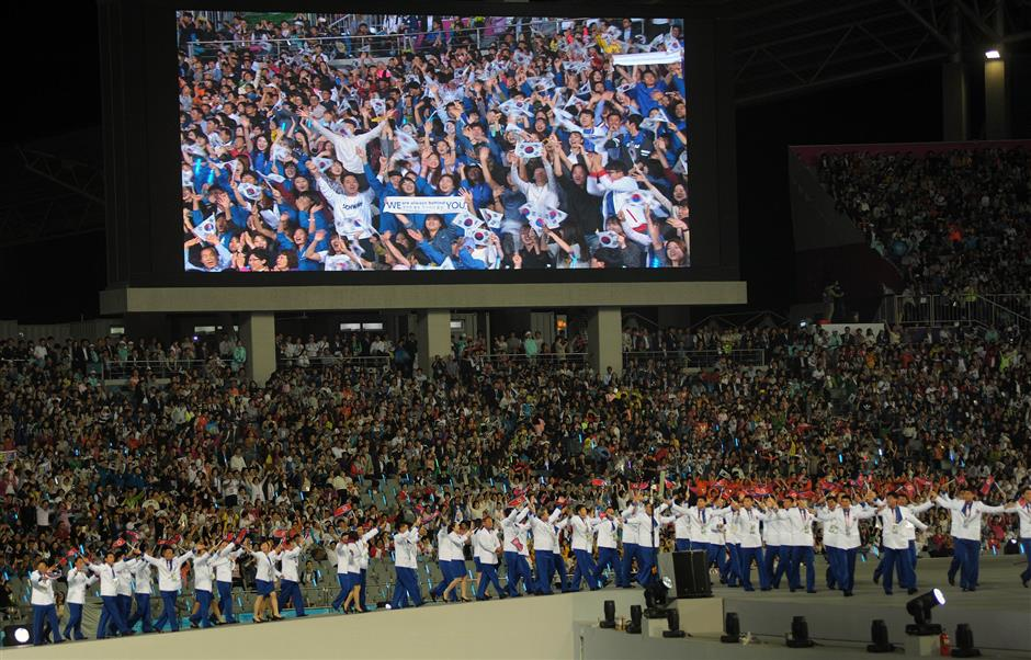South Koreans giving the North Korean delegation a rapturous welcome. - AFP
