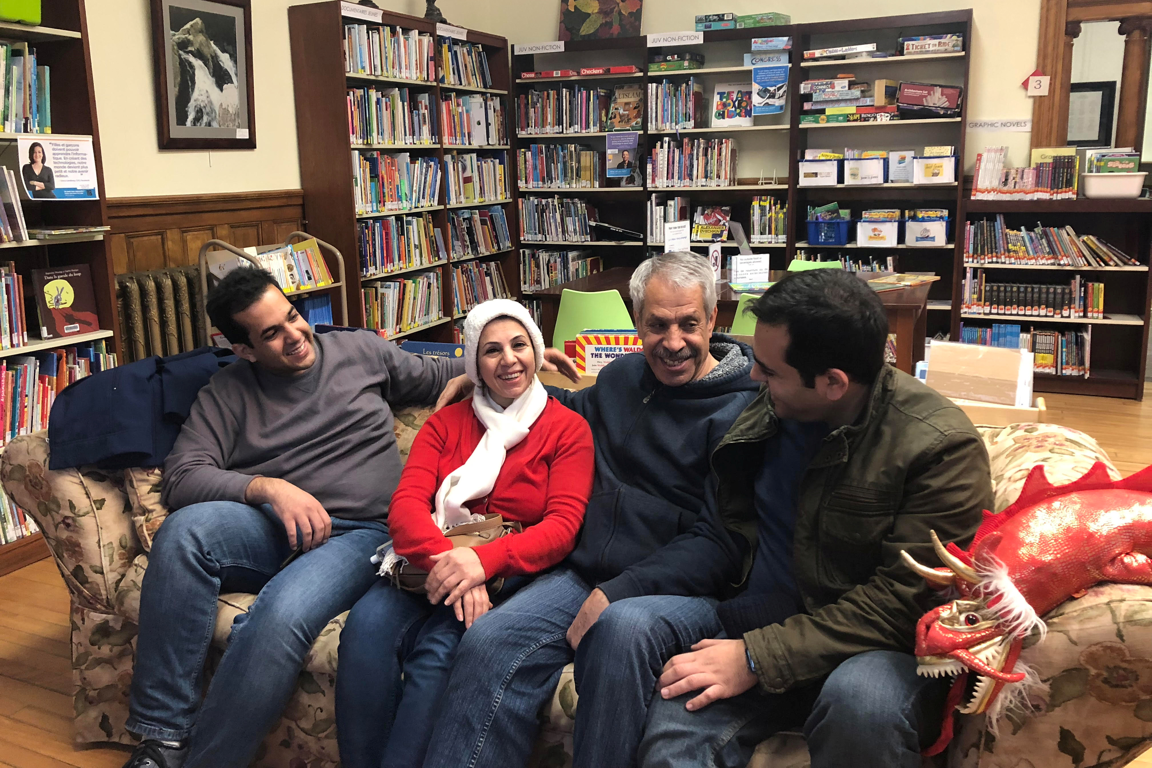 An Iranian family reunites at the Haskell Free Library and Opera House, which straddles the U.S.-Canada border in Stanstead, Quebec and in Derby Line, Vermont, U.S., November 3, 2018. Picture taken November 3, 2018. To match Insight USA-IMMIGRATION/BAN   REUTERS/Yeganeh Torbati