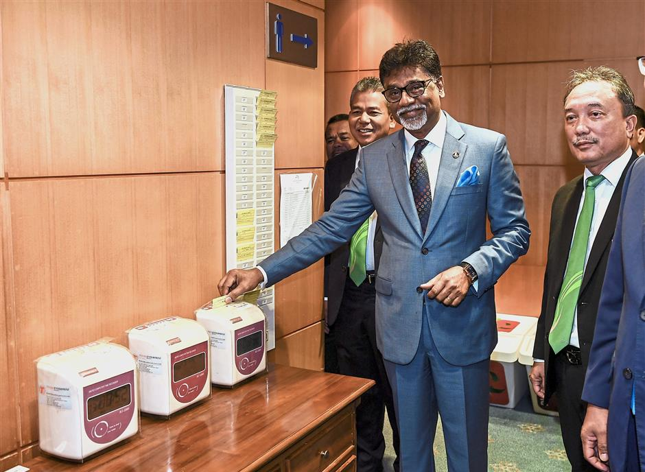 Clocking in: Dr Xavier never expected to become a minister but he is embracing his duties at the Water, Land and Natural Resources Ministry with dedication.