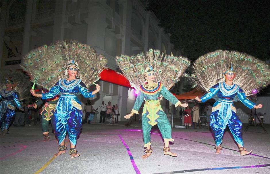 Indian traditional dancers performing a peacock dance at the event in Ipoh.