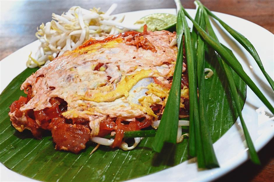 Phad Mee Korat, a red sauce version of the pad thai, from Korat Thailand.