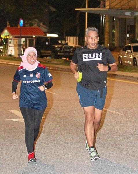 Running buddies Fadzil and Elleney Merynda Wasli. Fadzil runs for an hour, at least four times a week, after breaking fast.
