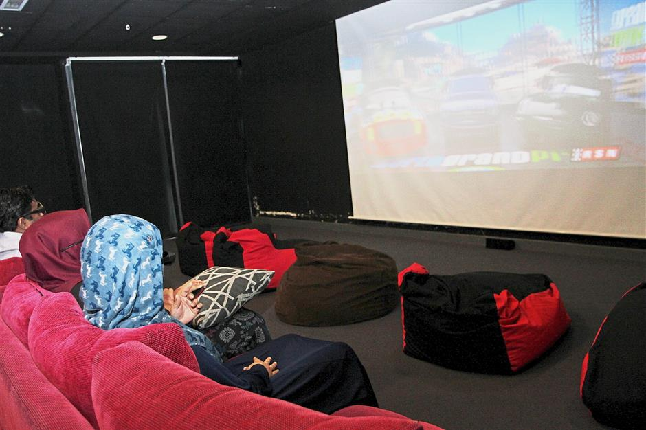The 3D theatre has comfortable sofas for the whole family to enjoy a movie.