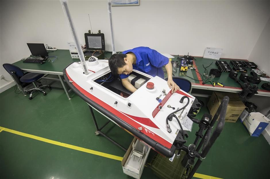 A technician assembles an unmanned surface vessel at an Oceanalpha Co. facility in Zhuhai, China, on Thursday, May 18, 2018. Oceanalpha, one of a handful of companies around the globe specializing in ocean-going drones that operate on the surface, has fired the interest of some of China's biggest venture capitalists. Photographer: Qilai Shen/Bloomberg