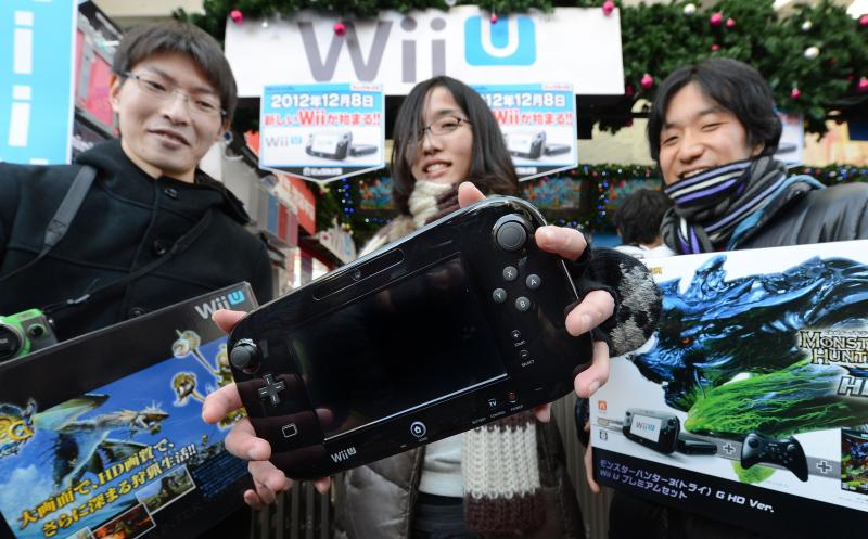 Customers in TOkyo displaying their purchases of Japanese electronics titan Nintendo's new videogame console 'Wii U' in December of 2012. China's decision, for now, to lift a 14-year-old ban on selling videogame consoles could pave the way for Nintendo, Sony Corp and Microsoft Corp to enter the world's third-largest video game market in terms of revenue - AFP Photo.