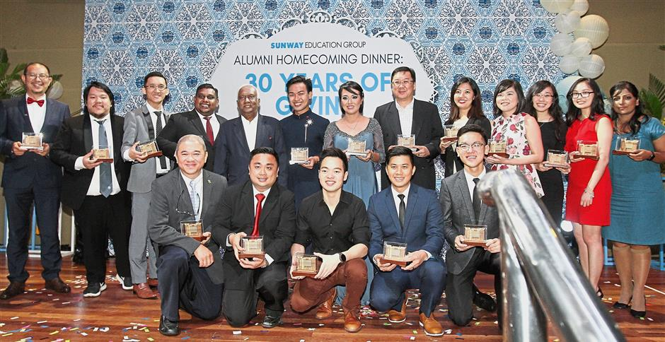 Navaratnam (fifth from left) with some of the 30 Sunway alumni who received awards in recognition of their achievements.
