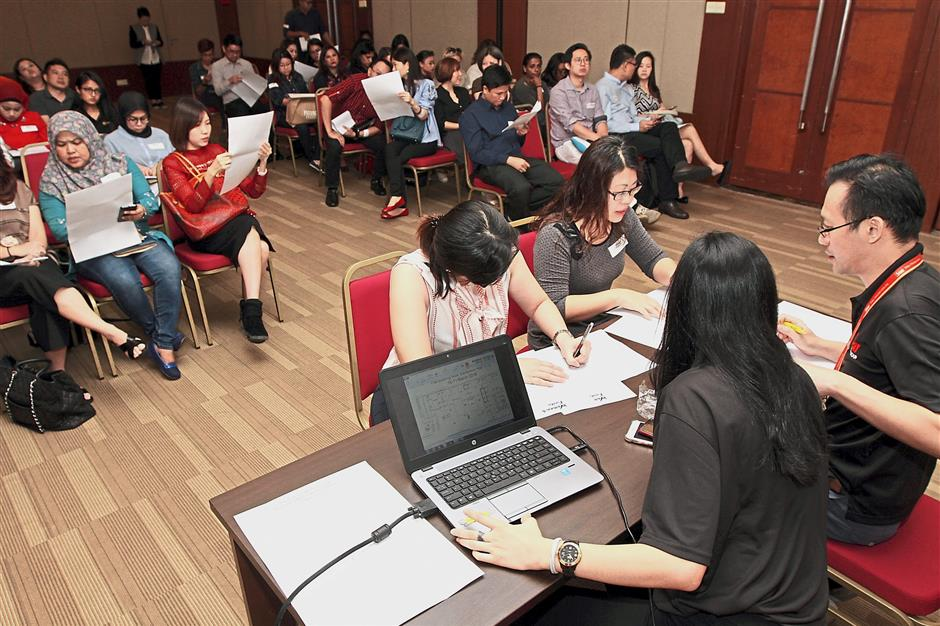 Exhibitors picking their booth location for The Star Womenu2019s Fiesta at a balloting session in Menara Star yesterday.