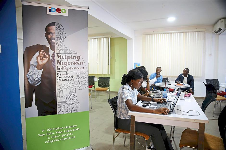 Software developers work on computer sytems at the Information Technology Developers Entrepreneurship Accelerator (iDEA) hub in the Yaba district in Lagos on June 25, 2015. – REUTERS Photo