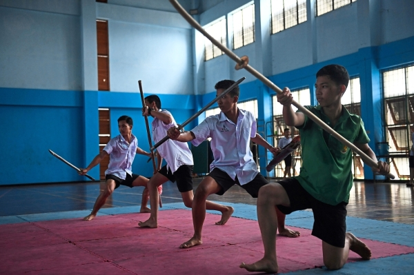 Cool moves: Teachers and students at the Thonburi school have added more moves and gymnast spins, giving fighters in action the appearance of blockbuster stunt doubles. u2014 AFP