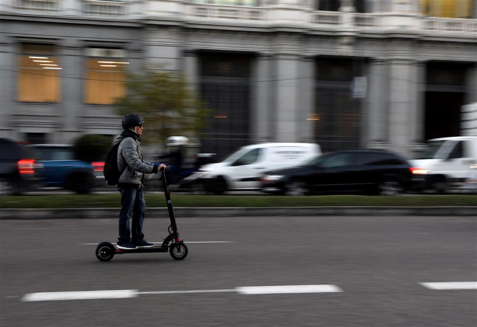FILE PHOTO: A man rides an electric scooter in Madrid, Spain, December 4, 2018. REUTERS/Susana Vera/File Photo