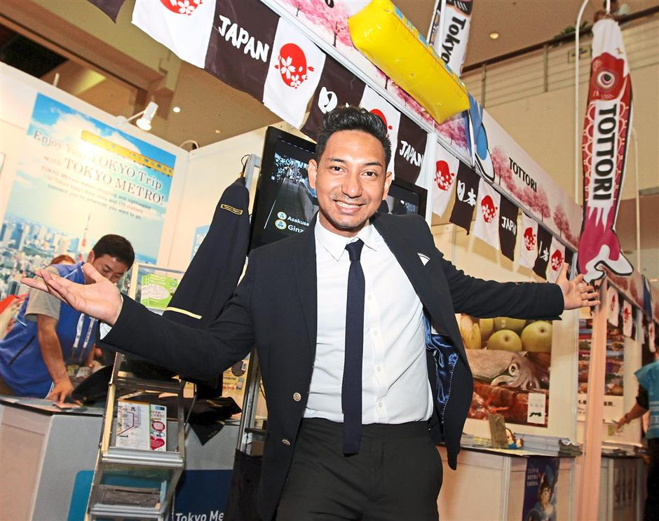 Celebrity support: Zizan Razak making a special appearance at the Japan Pavilion to the delight of his fans.