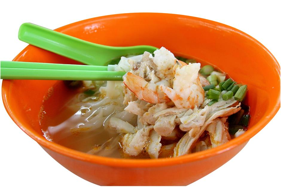 (Above) Diners hankering for a taste of authentic Penang white curry noodles can head to Lek Seng Kopitiam in Section 19, Petaling Jaya. (Below) Shredded chicken kuey teow soup is the other speciality at the stall.