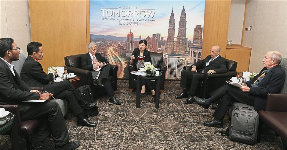 At the roundtable: (from left) StarBiz writer Ganeshwaran Kana, Nurhisham, Quah, Tan, Goldin and Price at the conference on A Better Tomorrow.