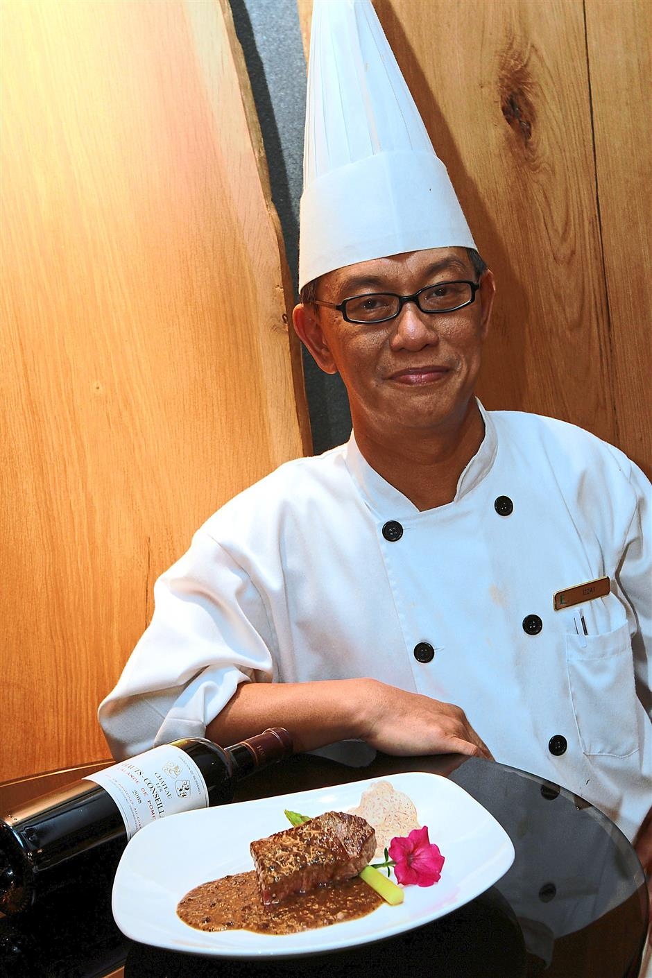Creative: Muhammad Izzat has more than 30 years experience in preparing Japanese cuisine.
