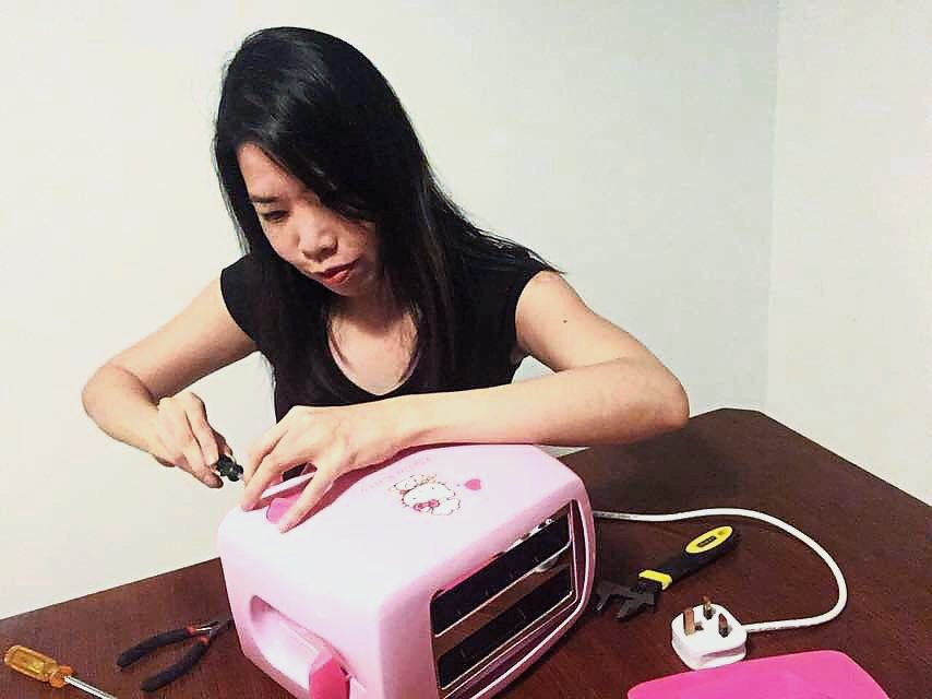 Lau repairing her special-edition Hello Kitty toaster at a Kaki Repair session.