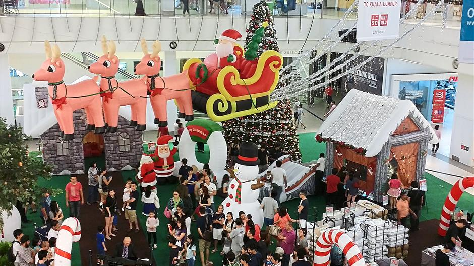 Tropicana City Mall's Inflatables Wonderland, which features an inflatable candy home, a log house with a children's slide, a bouncy Santa's castle and a carousel.